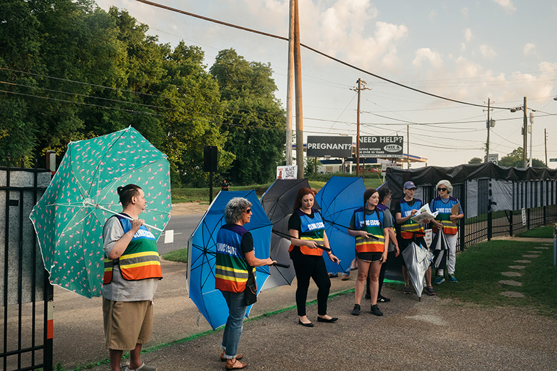 Clinic escorts use large umbrellas to shield patients from anti-abortion demonstrators at the Reproductive Health Services center in Montgomery, Alabama, on May 24.